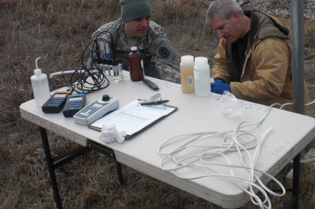 U.S. Army Public Health Command personnel, 1st Lt. Robert White, environmental science and engineering officer, and Mark Farro, supervisory engineering technician, process water samples taken at McAlester Army Ammunition Plant, McAlester, Okla. (Photo by James Maio)