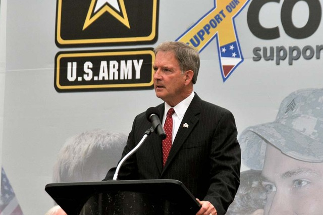 Congressman Bill Owens, who represents New York's 23rd District, addresses the Soldiers, Family Members and surrounding community of Fort Drum and the 10th Mountain Division (LI) during an Army Community Covenant renewal signing ceremony Friday in Watertown. Former Secretary of the Army Pete Geren launched the Army Community Covenant four years ago as a way of expanding the Army Family Covenant to local communities.