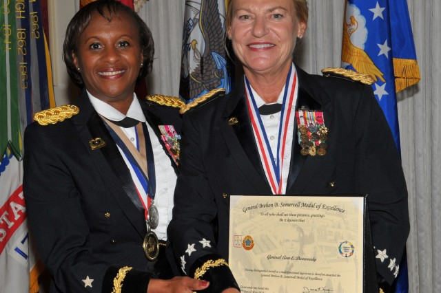 Brig. Gen. Gwen Bingham, U.S. Army Quartermaster General and Quartermaster School commandant, presents Gen. Ann E. Dunwoody, Army Materiel Command commanding general, with the Gen. Brehon B. Somervell Medal of Excellence during an honors ceremony held at the Quartermaster Ball on Fort Lee, Va., June 14, 2012. The Somervell award recognizes individuals who excel in the area of multifunctional logistical support.