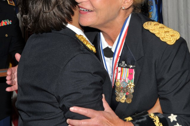 Gen. Ann E. Dunwoody, Army Materiel Command commanding general, hugs Brig. Gen. Gwen Bingham, U.S. Army Quartermaster General and Quartermaster School commandant, in appreciation after receiving the Gen. Brehon B. Somervell Medal of Excellence. The award was presented during an honors ceremony held at the Quartermaster Ball on Fort Lee, Va., June 14, 2012. The Somervell award recognizes individuals who excel in the area of multifunctional logistical support.