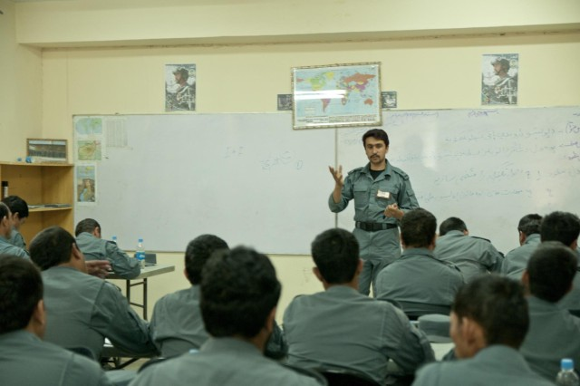 An Afghan Uniformed Police instructor at the Officer Candidate School located on Camp Nathan Smith, Afghanistan instructs a class of aspiring ANP officers June 12. The 69 students are expected to graduate Sept. 5, 2012.