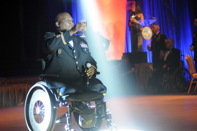 Col. Gregory D. Gadson, director of the U.S. Army Wounded Warrior Program, gives a toast to fallen comrades, June 16, 2012, during the 2012 Army Birthday Ball, in Washington, D.C.