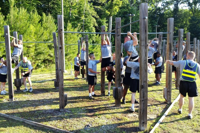 "Soldiers from the 7th Sustainment Brigade conduct ""Climbing Drills"" during an Army Physical Readiness Training Program exercise on Fort Eustis, June 8."