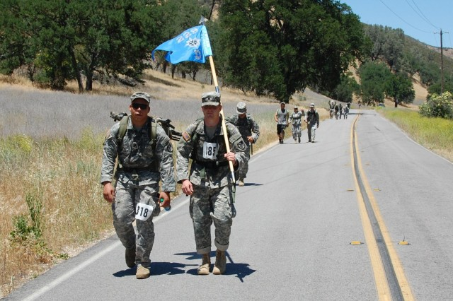 The 91st Training Division hosted the German Armed Forces Proficiency Badge qualification at Fort Hunter Liggett June 2-3. Competitors in the rucksack march head toward the finish line in the last event of the competition.