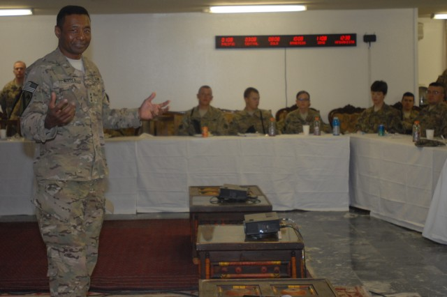"Lt. Gen. Thomas P. Bostick, U.S. Army Chief of Engineers and commanding general of the U.S. Army Corps of Engineers discusses issues with the command and soldiers of the 411th Engineer Brigade, Joint Task Force Empire, at Bagram Air Field June 8. ""Some of you look like your moms don't know you're here,"" Bostick joked as he looked upon some of the younger engineers."