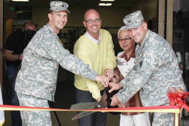 (From left): U.S. Army Garrison Torii Station Commander Lt. Col. Cory Anderton, Librarian Casey Grimmer, guest Nobu Taka Takaesu and 10th Regional Support Group Commander Col. Lance Koenig, cut the ribbon May 30, 2012, to signify the official grand reopening of the Torii Station Library in Okinawa, Japan, which now offers the Pirate Republic Coffee Shop and free Wi-Fi access, among many other new features.