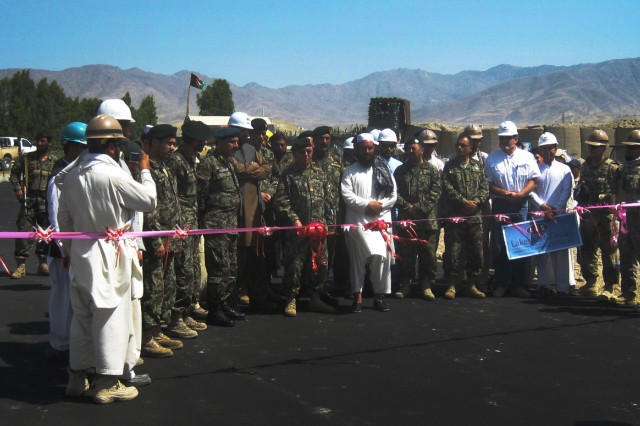 Leaders from the Afghan National Army, the U.S. Army Corps of Engineers and Lakeshore celebrate the completion of the Wadi Mitigation and Outer Perimeter Road Project, June 17, 2012, at the Afghan National Army's 201st Corps Garrison in Gamberi, Laghman Province, Afghanistan.