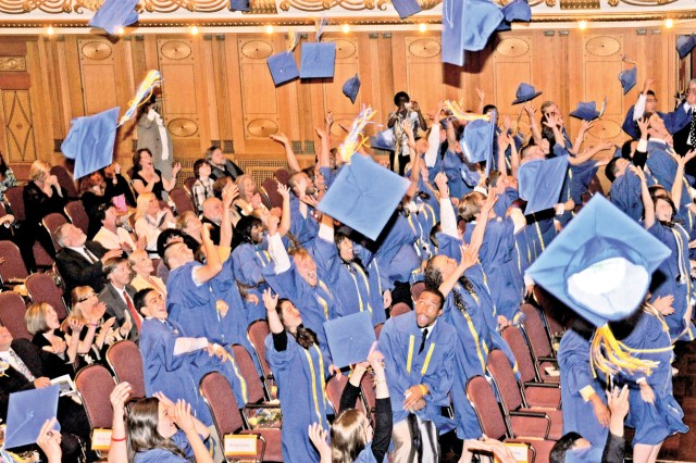 Members of Wiesbaden High School's class of 2012 toss their caps in the air during commencement in the Wiesbaden Kurhaus.