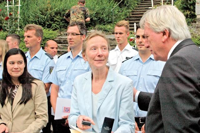 Hessen Minister President Volker Bouffier congratulates Anne Adams (center) and Heather Goodwin during Hessentag in Wetzlar.