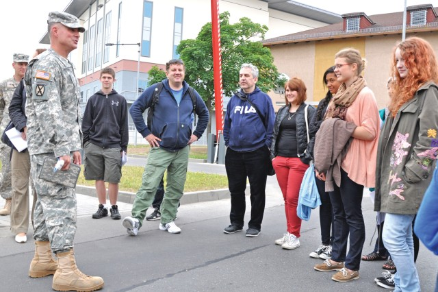 Col. David Carstens, U.S. Army Garrison Wiesbaden commander, describes the mission of U.S. Soldiers on Clay Kaserne during a visit by the German-American UnderstandinG project group.