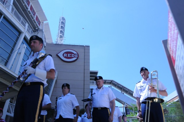 Just outside the stadium of the Great American Ball Park in Cincinnati, OH, the 100th Army Band entertains the fans as they stroll in on Flag Day, June 14 to watch the Cincinnati Reds play the Cleveland Indians. The band also played the National Anthem to begin the day and God Bless America during the seventh inning stretch.