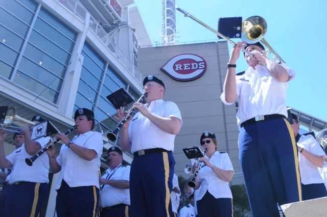 On Flag Day June 14, the 100th Army Band played at the Great American Ball Park, home of the Cincinnati Reds base ball team. Here, they play just outside the stadium entrance as fans file in. They played the National Anthem to begin the game and God Bless America during the seventh inning stretch.