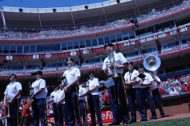 On the field of the Great American Ball Park in Cincinnati, OH, the 100th Army Band prepares to play the National Anthem on Flag Day, June 14 just before Cincinnati Reds play the Cleveland Indians. The band also played God Bless America during the seventh inning stretch.