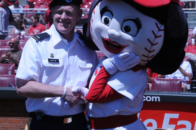 Chief Warrant Officer 5 Lawrence Barton, commander of the 100th Army Band meets Rosie Red one of the mascots for the Cincinnati Reds baseball team. The 100th played the National Anthem on Flag Day, June 14 at the Great American Ball Park in Cincinnati as well as God Bless America during the seventh inning stretch.