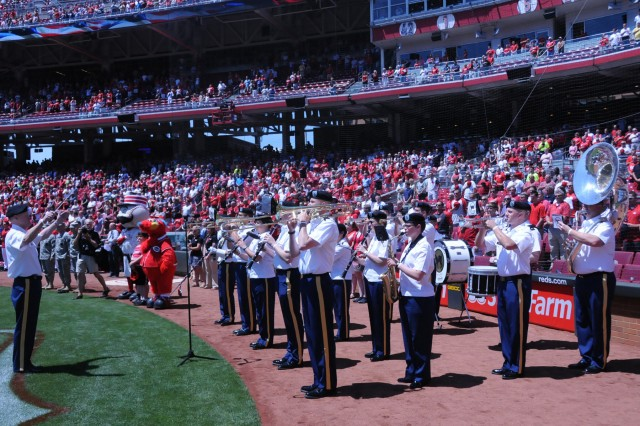 The 100th Army Band from Fort Knox, Ky. performs the National Anthem on Flag Day, June 14, at the Great American Ball Park in Cincinnati, Ohio at the beginning of a match up between the Cincinnati Reds and the Cleveland Indians. The band also played a few tunes just ouytside the gate as fans entered the stadium as well as God Bless American during the seventh inning stretch. The Reds won 12-5.