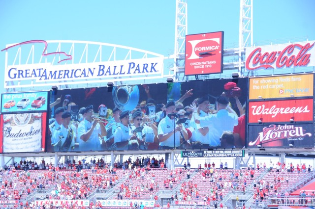 Broadcast over the jumbo tron are members of the 100th Army Band performing for approximately 30,000 baseball fans at the Great American Ball Park on Flag Day, June 14. The band traveled from Fort Knox, Ky. to perform at a Cincinnati Reds home game against the Cleveland Indians. They played just outside the gates as fans entered, performed the National Anthem at the beginning of the game and God Bless America (pictured) during the seventh inning stretch.