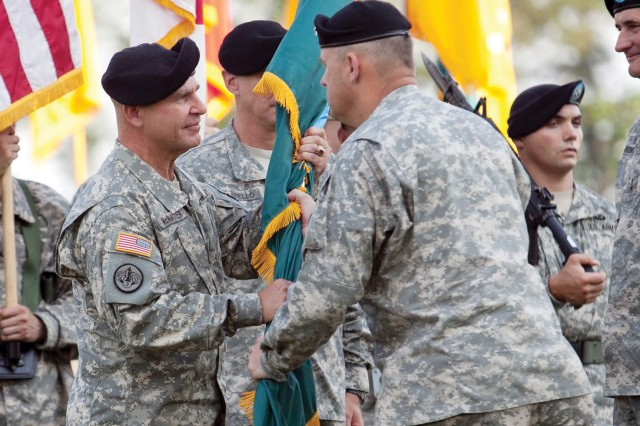 Maj. Gen. H.R. McMaster, left, receives the MCoE colors from Lt. Gen. David Halverson, the U.S. Army Training and Doctrine Command's deputy commanding general and chief of staff, at Wednesday's change of command ceremony.