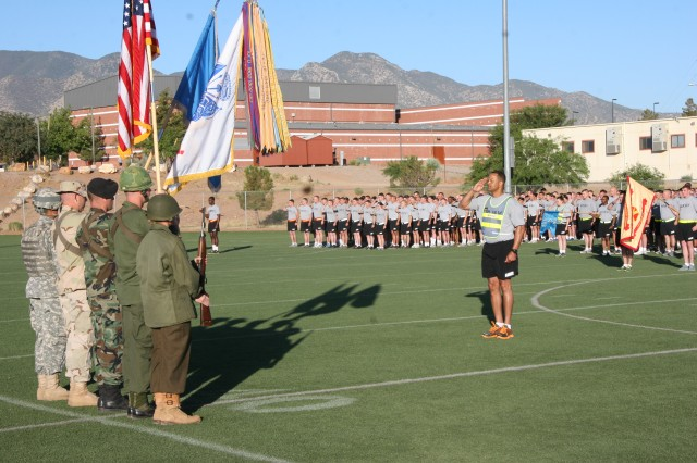 Participating units stand at attention while the Fort Huachuca Honor Guard presents the colors to those waiting on the field. The Honor Guard's uniforms pay homage to Soldiers who served in past conflicts.
