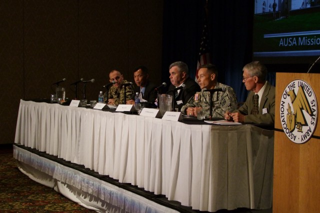 "(Right to left) retired Lt. Gen. Donald Holder Jr., Brig. Gen. Gordon B. Davis, Jr., Leonard Wong, James C. Lacey, and Col. (GS) Werner Albl discuss ""Mission Command Leader Education"" during the Mission Command Symposium, Kansas City, Mo., June 19, 2012."