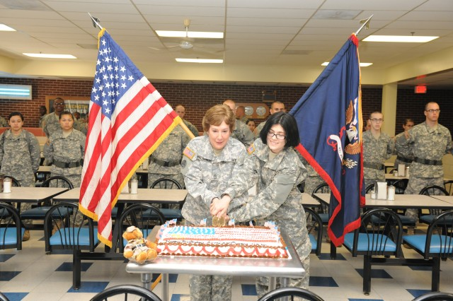 The 43rd Adjutant General Battalion's oldest and newest Soldiers, Master Sgt. Eloise Walbridge, 51, battalion S1, and Pvt. Kimyona Warren, 17, cut the Army Birthday Cake at the 43rd AG Bn. June 14. Warren had only just been issued a uniform minutes prior to the cake cutting. Walbridge plans to retire in January after 27 years of service.