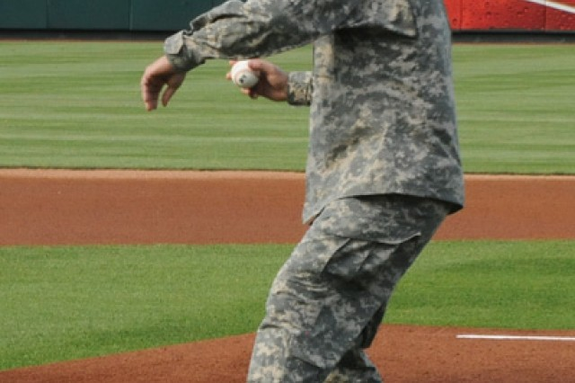 Maj. Gen. Mark Yenter, Maneuver Support Center of Excellence and Fort Leonard Wood commanding general, prepares to throw one of the first pitches during the opening ceremonies of a Springfield Cardinals game in Springfield, Mo., June 16, 2012.