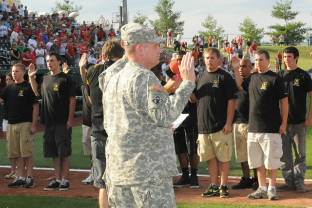 Maj. Gen. Mark Yenter, Maneuver Support Center of Excellence and Fort Leonard Wood, Mo., commanding general, leads 30 new recruits in the oath of enlistment at Hammons Field in Springfield, Mo., during the opening ceremonies of a Springfield Cardinals game, June 16, 2012.