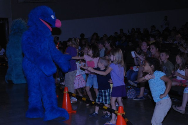 Sesame Street character Grover greets children at the USO Sesame Street Experience for Military^Families June 13 at Abrams Theater.