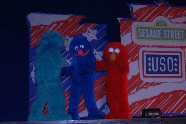 Characters from the USO^Sesame Street Experience for Military Families entertain more than 700 children June 13 at Abrams Theater. The program, geared for children ages 1-6, is designed to educate children about moving as part of a military Family. Organizers provided two performances for Fort Leonard^Wood Families.