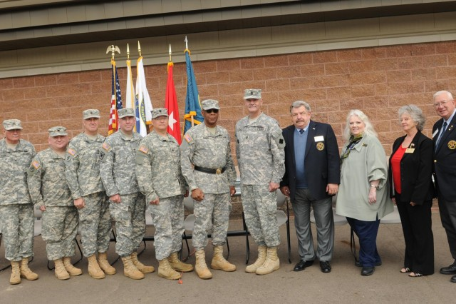 Judy Robinson, representative for Congressman Tim Walberg, Lt. Col. , Susan Baldwin, mayor of Battle Creek, Mich., Brig. Gen. Michael A. Stone, Command Sgt. Maj. Michael B. Koszuta (rear), Brig. Gen. Alton G. Berry, Army Reserve ambassadors; Max Bauman and Paul R. DeSander, attend the ribbon cutting ceremony at the dedication of Fort Custer Reserve Center in Battle Creek, Mich., June 2, 2012.