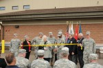 Dignitaries cut the ribbon at the dedication of Fort Custer Reserve Center