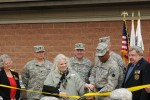 Diginitaries at the Fort Custer Reserve Center cut the ribbon at the Fort Custer Reserve Center Dedication