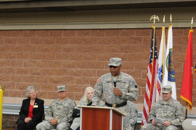 Brig. Gen. Alton G. Berry, commanding general 88th Regional Support Command, gives remarks to an audience at the Fort Custer Reserve Center and Area Maintenance Support Activity, in Battle Creek, Mich., to community members, soldiers, during the ribbon cutting, June 2.