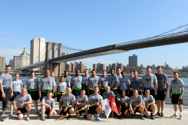 Soldiers from 10th Mountain Division (LI) pose for a picture near the Brooklyn Bridge after a company run Friday to show the local community how the Army conducts morning physical training.