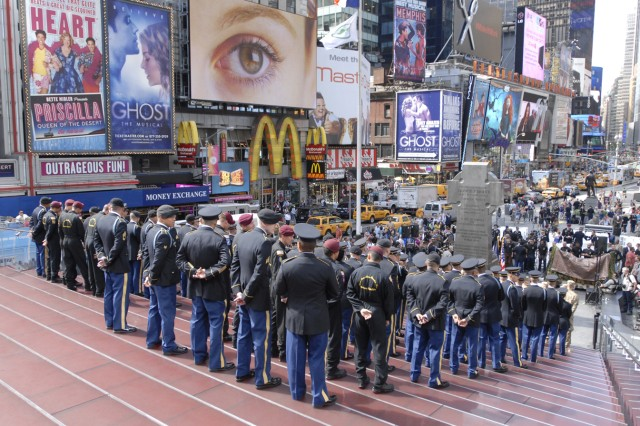 People gather at Times Square for the cake-cutting ceremony for the Army's 237th birthday on Thursday. Soldiers from the 10th Mountain Division (LI), Honor Guard, Old Guard and the Golden Knights posed in front of the crowd during the event.