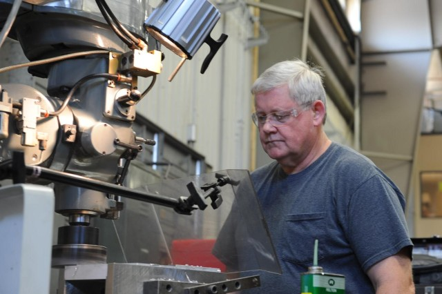 Charles Israel, a machinist and tool maker in Anniston Army Depot's Component/Flexible Computer Integrated Manufacturing Machining Branch, says machine guards frequently save him from burns by metal shavings.