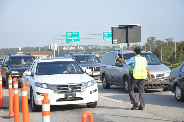 Line Grant, a Fort Jackson gate guard, stops a driver at Gate 2 Tuesday. The gate, which is the main access point for many to get on post, will close forrenovations starting July 9. The renovation will include visual upgrades and lane modifications to enhance traffic flow.
