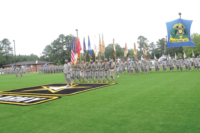 Soldiers of the 23rd Quartermaster Brigade, led by Command Sgt. Maj. Charles Penn, move toward the reviewing stand during the Regimental Review/Hall of Fame Induction Ceremony held June 14 at the 262nd QM Battalion Parade Field.