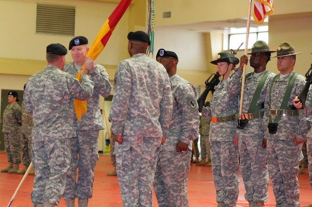 Col. Michael Dvoracek receives the unit colors from Maj. Gen. Mark McDonald, Fires Center of Excellence and Fort Sill commanding general, during the 434th Field Artillery Brigade change of command ceremony June 12 at Rinehart Fitness Center.
