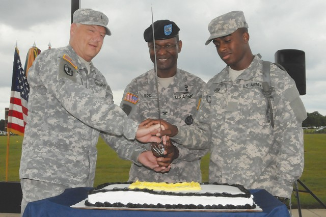 Col. Rodney Edge, U.S. Army Garrison and For Lee, commander, cermoniously cuts the Army birthday cake with Chief Warrant Officer 5 Leon Ewert and Pvt. Tacarris Lester, the oldest and youngest Soldiers on the installation, respectively.