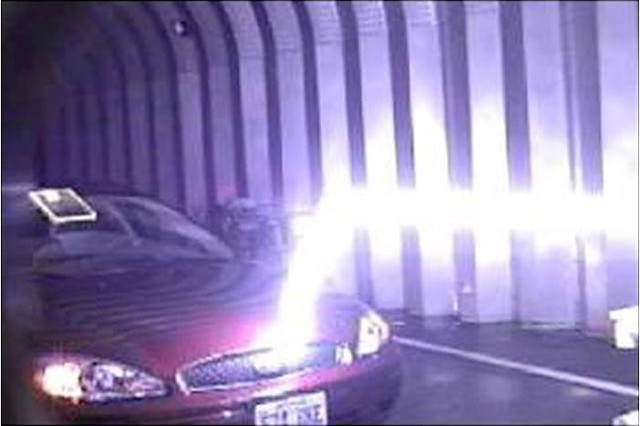 A guided lightning bolt travels horizontally, then hits a car when it finds the lower resistance path to ground. The lightning is guided in a laser-induced plasma channel, then it deviates from the channel when it gets close to the target and has a lower-resistance path to ground. Though more work needs to be done, Picatinny Arsenal engineers believe the technology holds great promise.