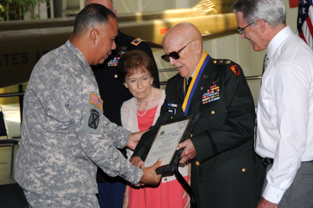 Maj. Gen. Anthony G. Crutchfield, U.S. Army Aviation Center of Excellence and Fort Rucker commanding general, presented the Order of St. Michael Bronze Award to retired Maj. Roy Howell and his Family June 18 at the U.S. Army Aviation Museum.