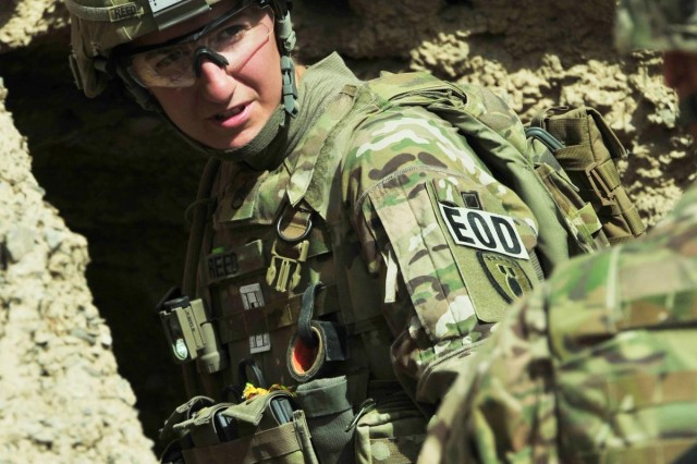 Staff Sgt. Kendall Reed, 630th Explosive Ordnance Disposal Company, communicates with another soldier before clearing a known cache site during Operation Southern Strike II near Yaro Kalay, Afghanistan, June 4, 2012. Reed is from Scappoose, Ore.