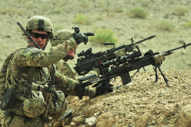 Cpl. Carson Hitchens armed with M14 rifle gives directions to another soldier during Operation Southern Strike II in southern Afghanistan, June 6, 2012. Hitchens is from Highpoint, N.C.
