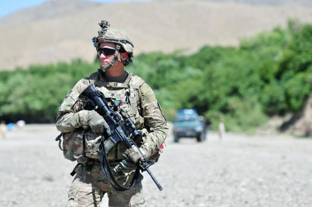Spc. Justin Mullen, combat medic with 1st Battalion, 17th Infantry Regiment, 2nd Infantry Division, scans his sector during a patrol in Enjergay, Afghanistan, June 2, 2012. Mullen is a native of Oxford, Pa.