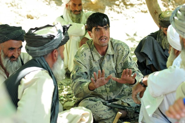 A member of the Afghan Border Police voices his concerns during a shura meeting with local elders in the village of Enjergay, Afghanistan, June 2, 2012. The ABP is concerned about the reluctance of local villagers to provide information regarding the placement of roadside bombs fearing Taliban retaliation.