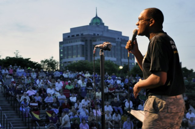 Staff Sgt. Justin Wade, the lead singer for the 94th Army Rock Band, gets the audience energized during the band's performance at the City of Albany Father's Day and Army Birthday Concert on June 17.