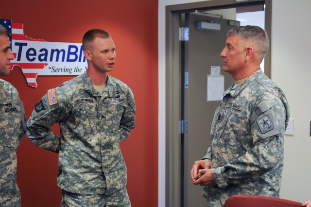 Sgt. Kenneth Harryman, winner of the 2012 Fort Bliss Iron Warrior of the Year competition, talks with the Sgt. Maj. of the Army Raymond Chandler III, June 20, 2012, at Fort Bliss, Texas, about the Iron Warrior competition. Harryman, a squad leader with F Company, 51st Infantry Regiment, 1st Brigade Combat Team, 1st Armored Division, was named the Iron NCO of the Year, June 6, 2012.