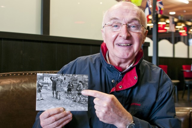 Yeves Tariel points to a picture of himself as a young boy playing Nazis and the French Resistance in Lisieux, France, just before his town was bombed by U.S. planes during World War II.
