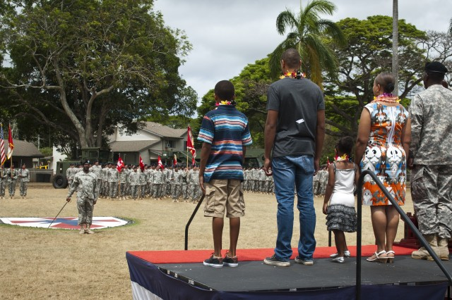 Command Sgt. Maj. Roy Ward, outgoing command sergeant major of the 130th Engineer Brigade, 8th Theater Sustainment Command, and his family conducts a final pass and review of the brigade before he departs for a new command, during the brigade's change of responsibility at Hamilton Field on Schofield Barracks, June 20.