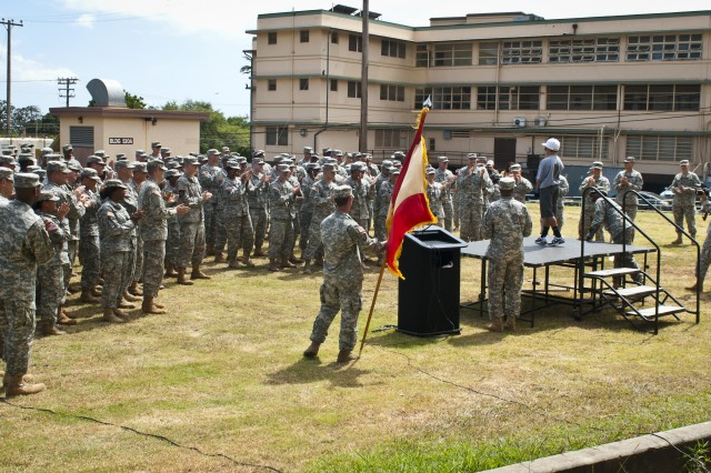Diego Nikitas, 10, and student at Webling Elementary School, performs a rap about the Army in front of more than 100 Soldiers in the 8th Special Troops Battalion, 8th Theater Sustainment Command.